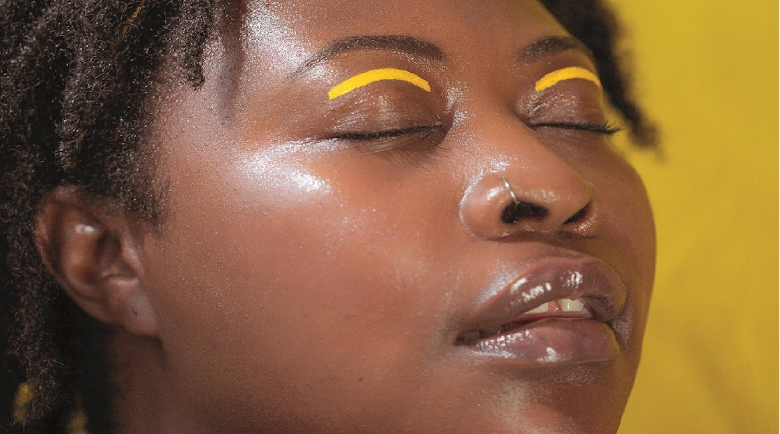 Woman with yellow eye makeup